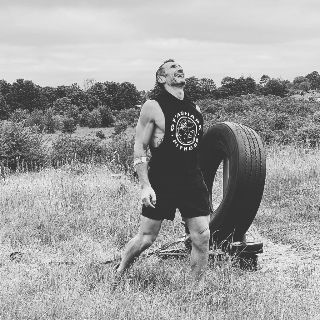 Brian our Personal Trainer exercising with tire