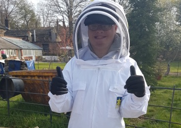 Byron in his bee suit and with his thumbs up