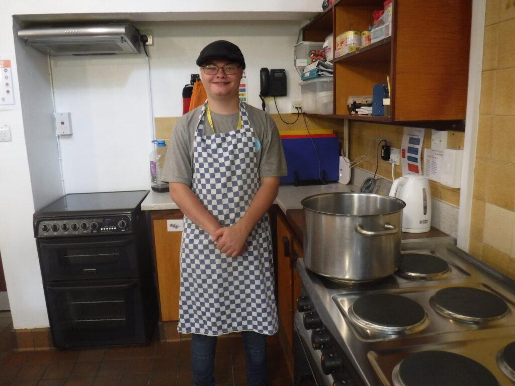 Byran_wearing_apron_in_kitchen